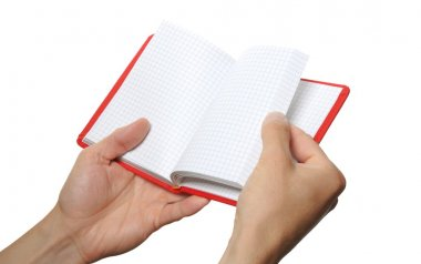 Opened book in hand