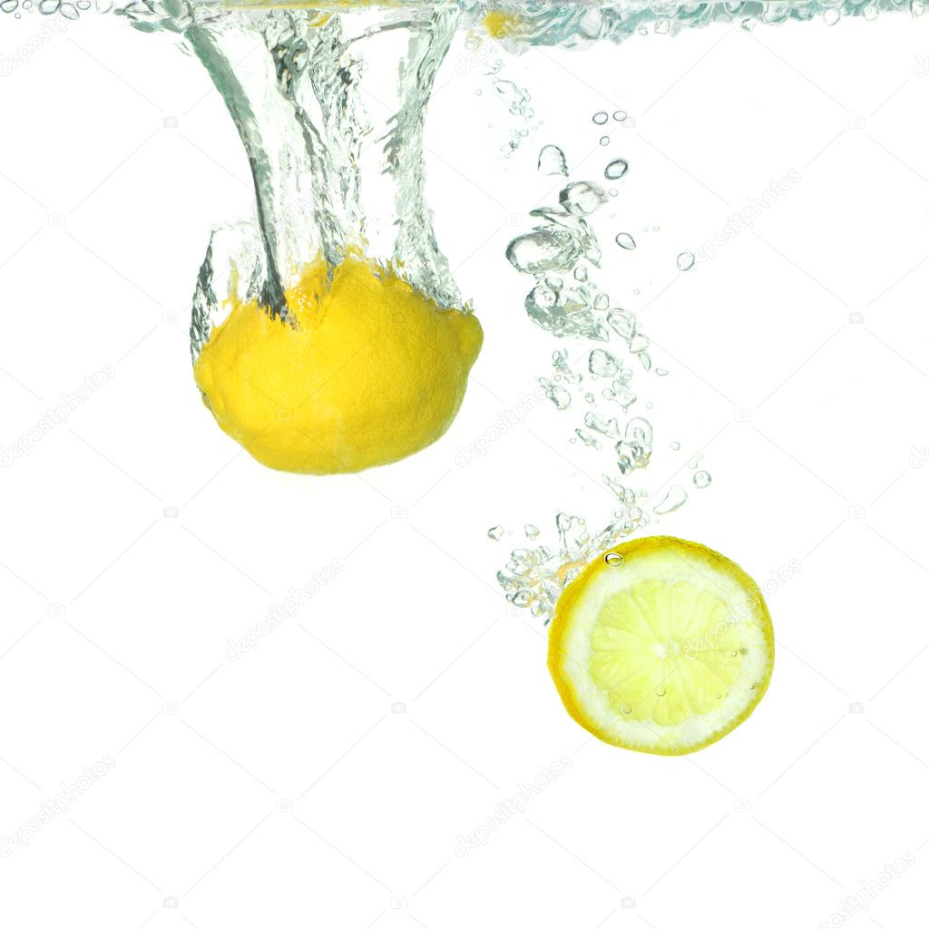 Lemon and a slice lemon falling in water