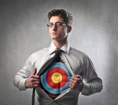 Young businessman showing a target under his shirt
