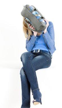 Sitting woman with handbag stock vector