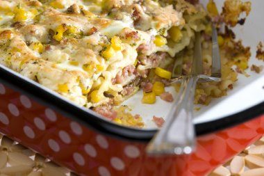 Pasta baked with smoked meat and corn