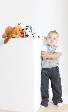 Standing toddler with toys