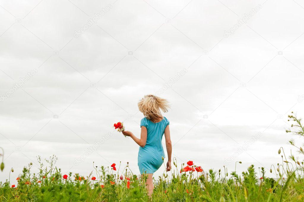 Woman in poppy field