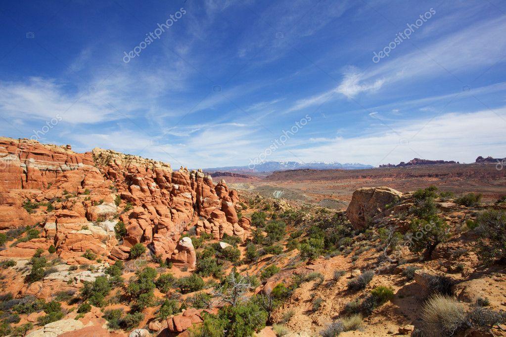 Wispy skys over Brown rocks