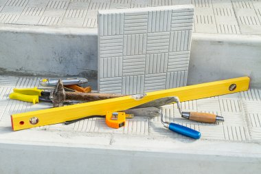 Paving slabs and tools for laying tiles