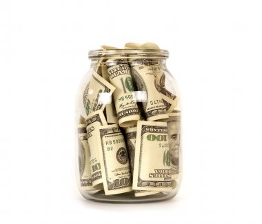 One hundred dollar bills in a glass jar
