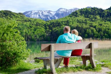 Elderly couple rests on bench