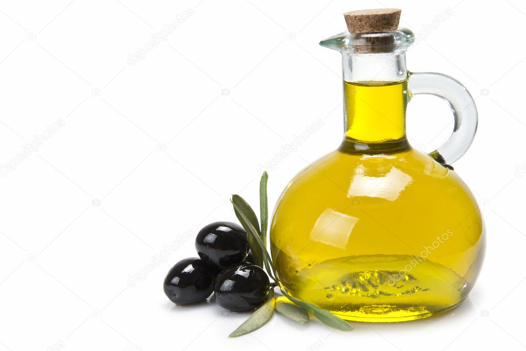 Jar with olive oil and black olives.