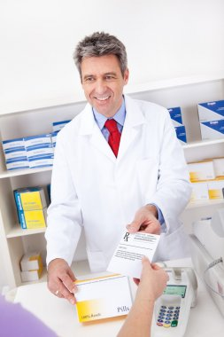 Buying prescription medicine at drugstore