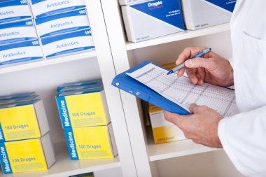 Pharmacist checking drugs