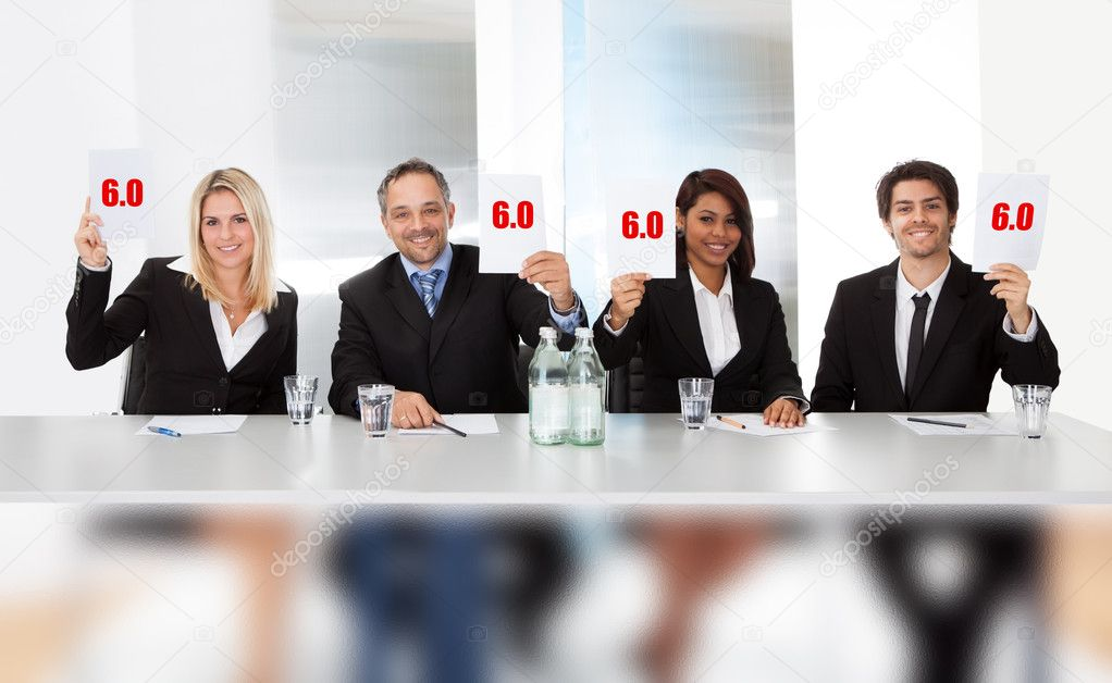 Panel judges holding perfect score signs