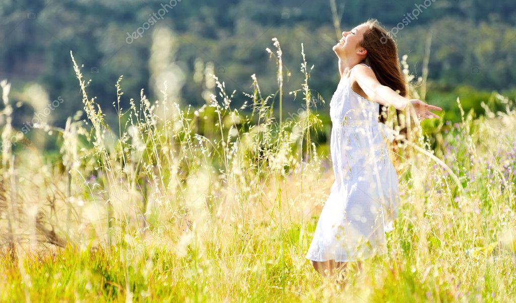 Sunset dancing meadow girl