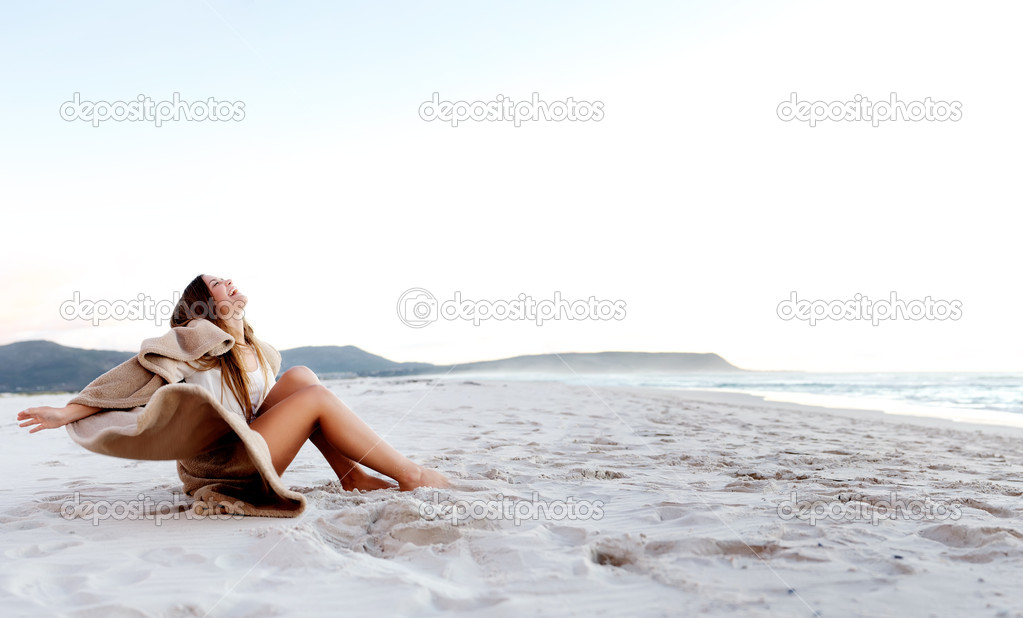 Beach blanket woman
