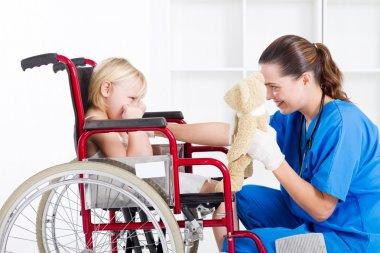 Nurse cheer up sad little girl patient