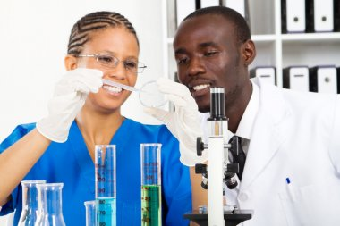 African american lab technicians doing experiment