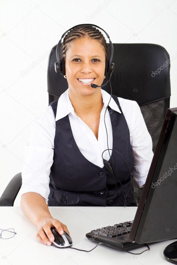 Customer service consultant sitting at desk — Stock Photo ...