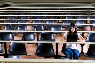 Female college student in university lecture hall