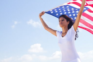 Young beautiful woman holding USA flag