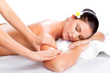 Young beautiful woman receiving massage
