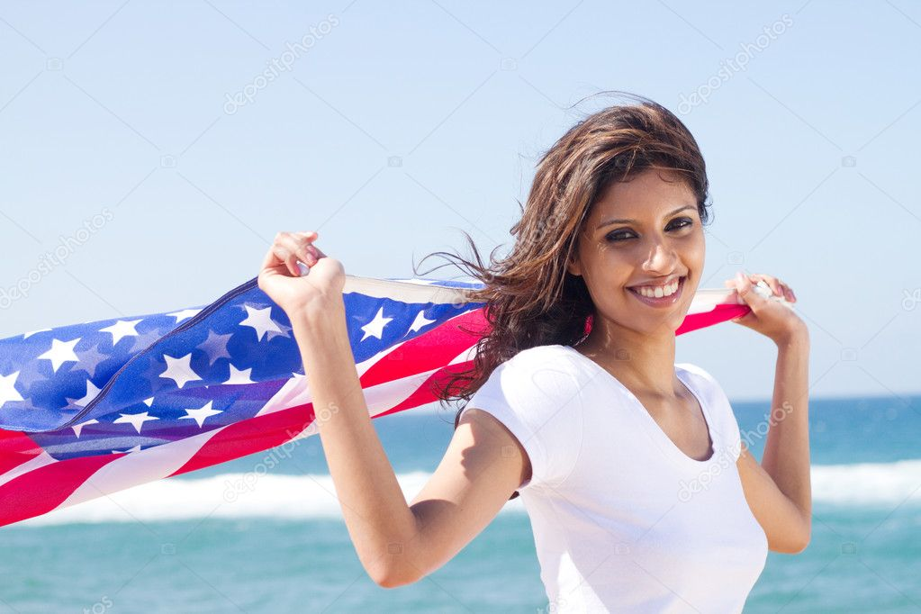 Beautiful young woman with american flag