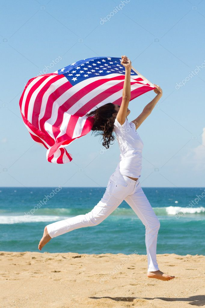 Young active woman holding american flag