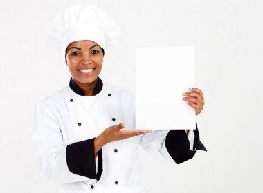 African american female chef presenting menu