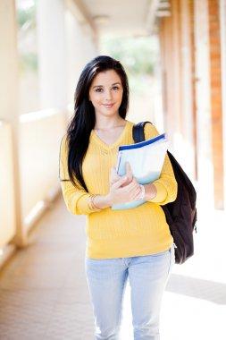 Female university student walking down corridor