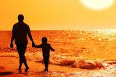 Fotografie Kind mit seinem Vater auf See am Sunset Boulevard