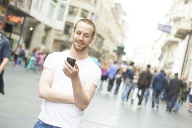 Man with phone walking