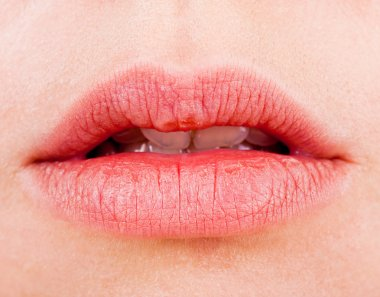 Natural women's sensual lips closeup