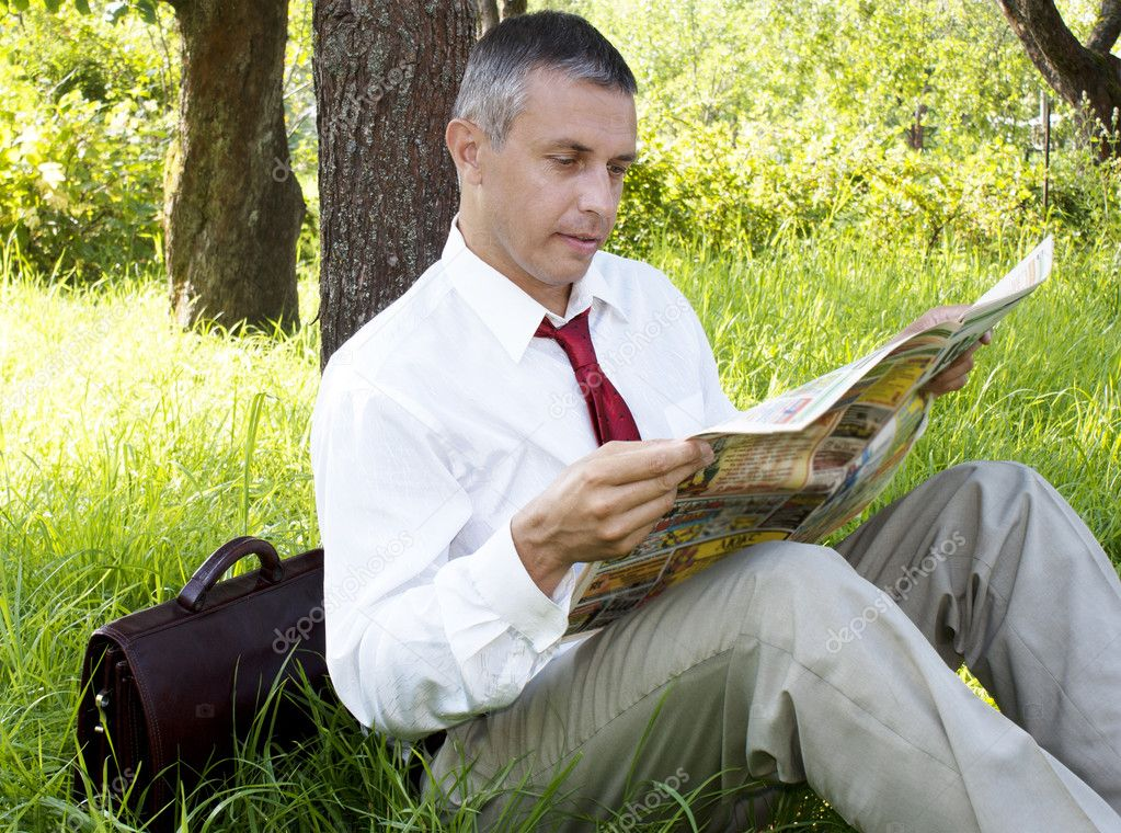 The businessman reads the newspaper