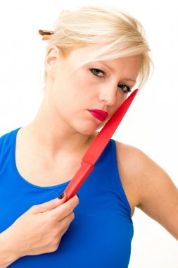 Woman is holding a knife