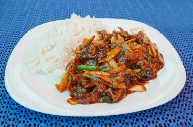 Chinesse lunch with fried beef bamboo shoots and rice
