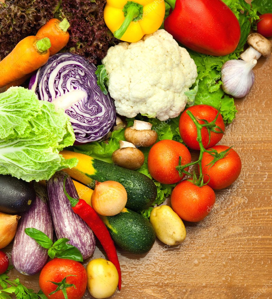 Assortment of fresh Organic Vegetables / on the Wooden Desk
