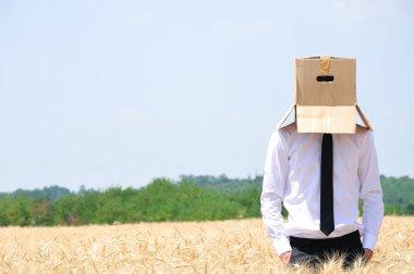 Business Man hiding face