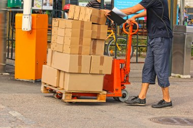 A fork pallet truck stacker with stack of boxes