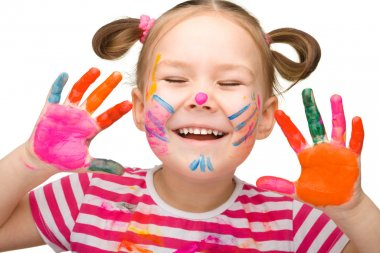 Portrait of a cheerful girl with painted hands