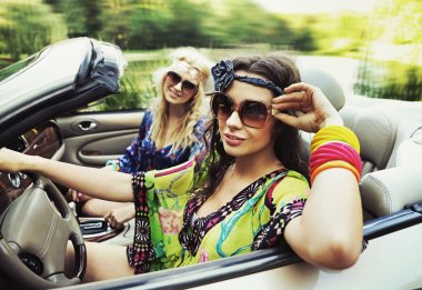 Smiling women in a cabriolet