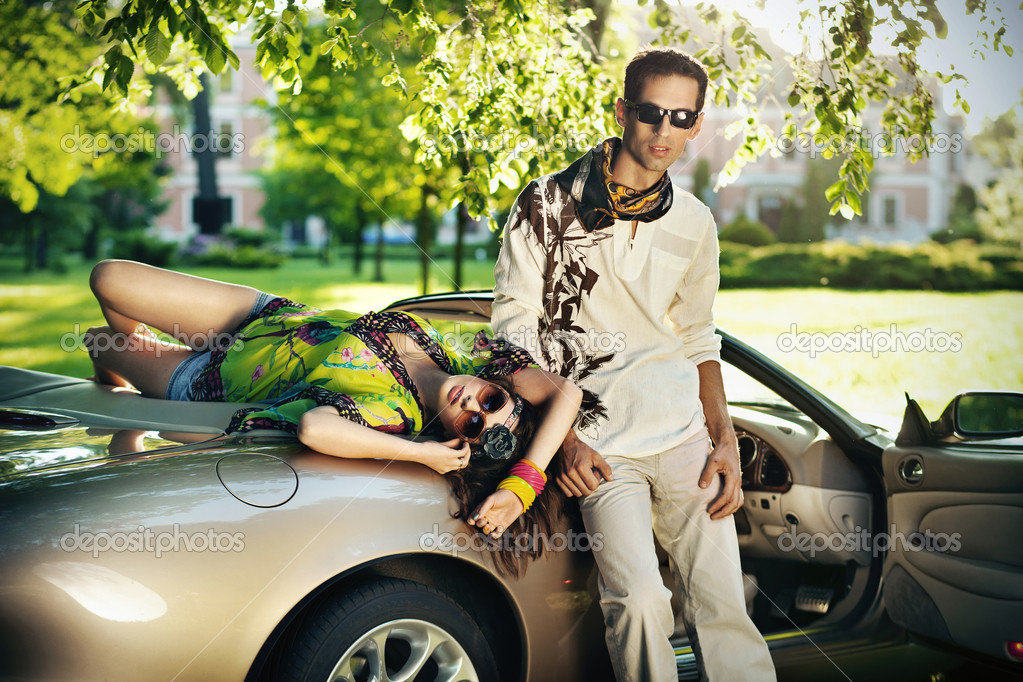 Young couple in cabriolet