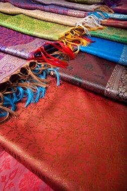 Different beautiful fabrics with fringe