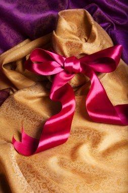 Ribbon, bow and fabric