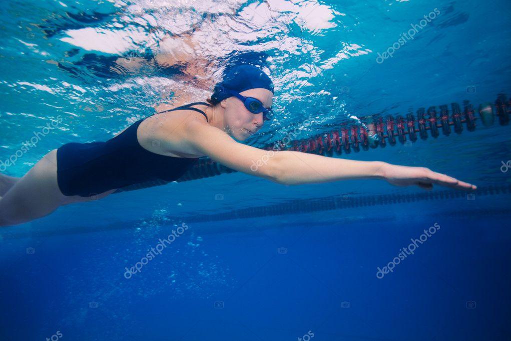 Sportsman woman swimming in crawl (stroke) style