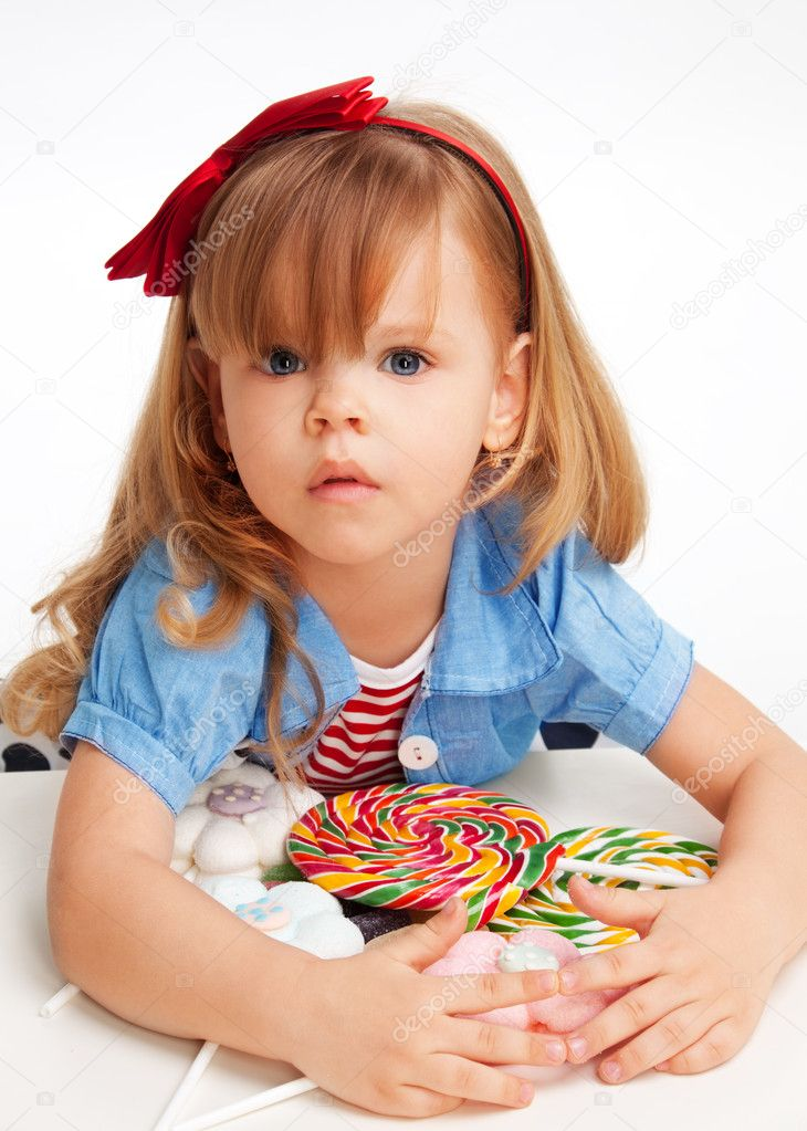 Greedy Girl With Pile Of Sweets Stock Photo 169 Serrnovik
