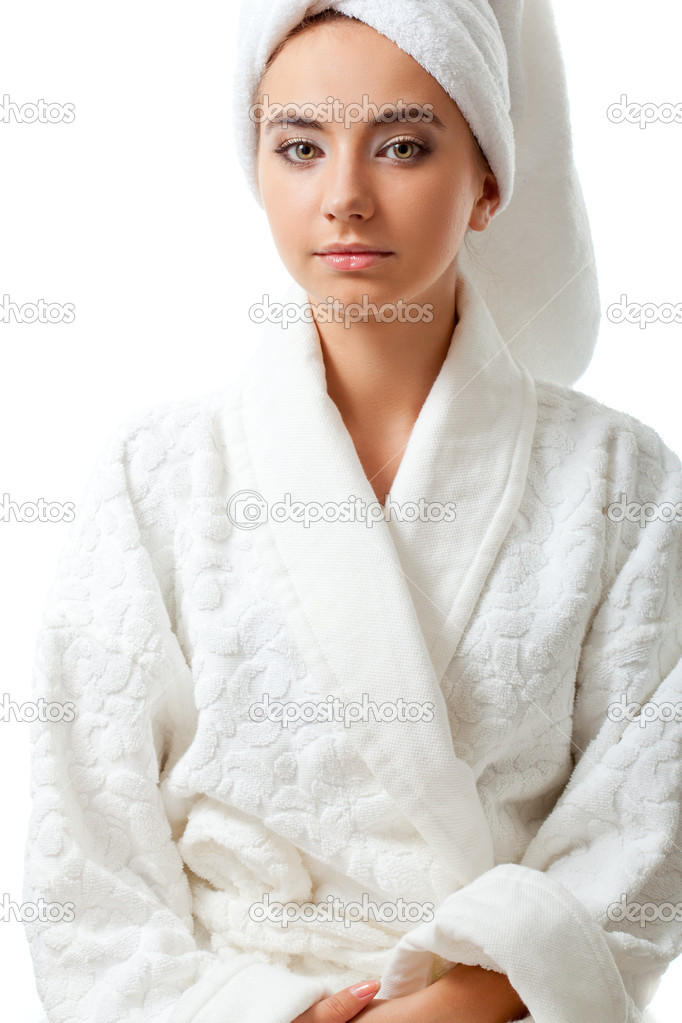 Closeup woman portrait wearing bathrobe over white background — Photo by  chesterf af450d462