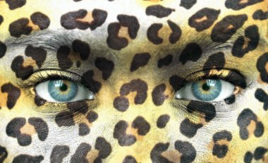 Human face with animal patterns - Save endangered species concep