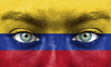 Human face painted with flag of Colombia