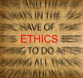 Blured text on vintage paper with focus on ETHICS