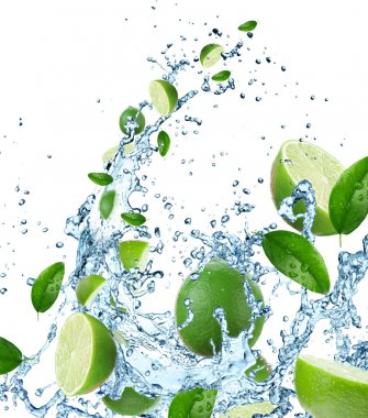 Fresh limes in water splash