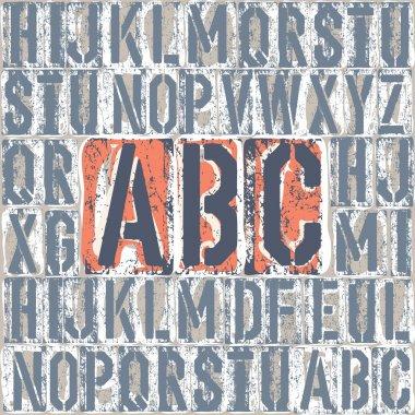 Vintage letterpress printing blocks alhpabet. Grouped separately
