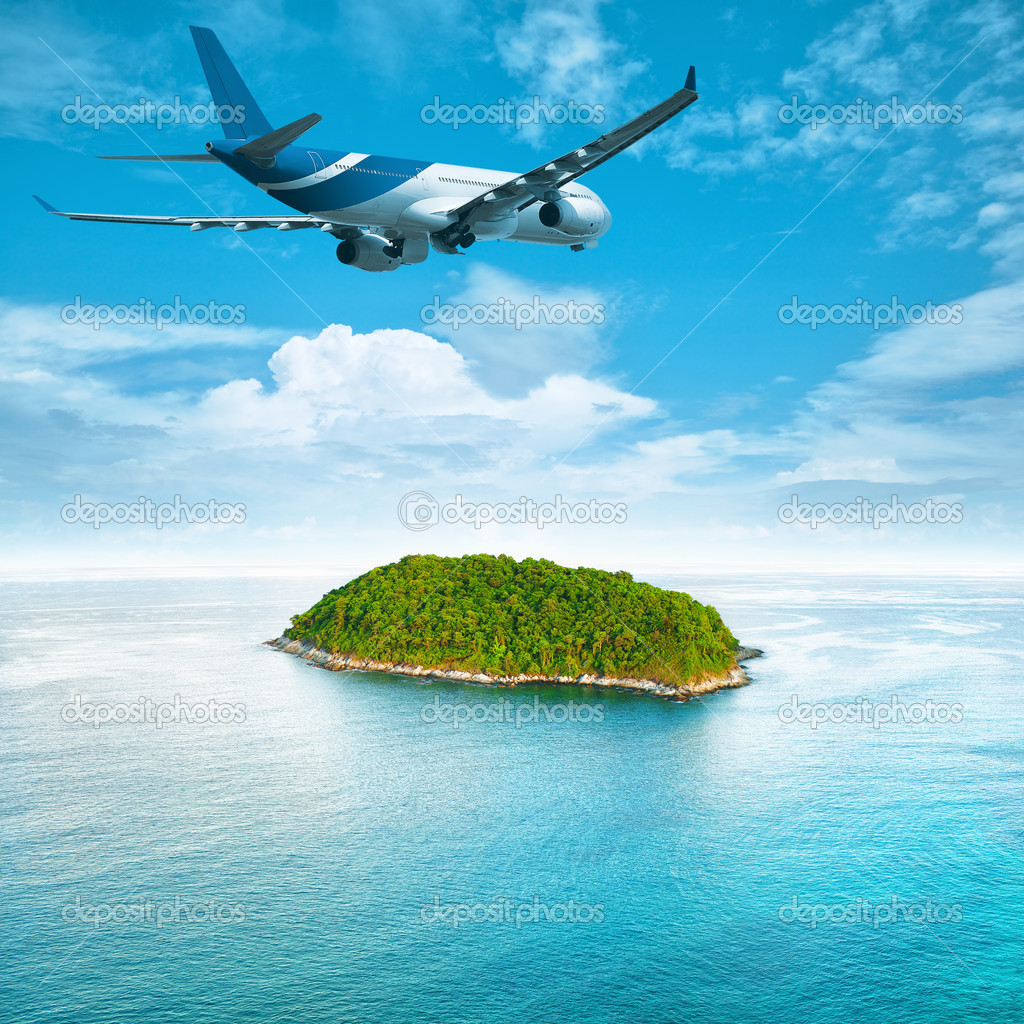 Jet plane over the tropical island